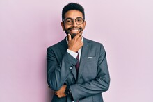 Handsome Hispanic Business Man With Beard Wearing Business Suit And Tie Looking Confident At The Camera Smiling With Crossed Arms And Hand Raised On Chin. Thinking Positive.