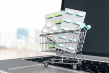 Business Pharmacy Online With Pills In Shopping Cart On Laptop On Abstract Background