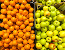 Apples And Tangerines In Boxes On The Counter In The Supermarket. Mobile Photo