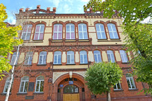CHERNYAKHOVSK, RUSSIA - AUGUST 16, 2019: Facade Of The Building Of Secondary School Number 6 (formerly A Secondary School For Boys, 1902). Kaliningrad Region