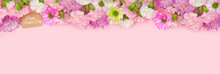 Happy Mothers Day Gift Tag With Long Top Border Of Pink And White Flowers. Above View On A Pink Banner Background. Copy Space.