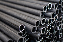 Stack Of Steel Pipes For Industrial Background. Selective Focus
