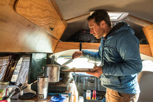 A Man Cooking A Climber's Breakfast In His Van, Cochise Stronghold, Dragoon Mountains, Tombstone, Arizona.