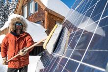 A Man Clearing Of The Solar Panels At The Aladdin's Lamp Hut, Molas Pass, Silverton, Colorado.