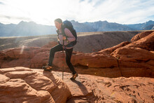 A Woman Hiking At Calico Hills, Red Rock Conservation Area, Las Vegas, Nevada.