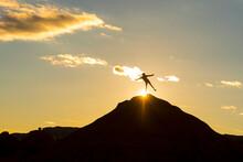 A Girl Standing On A Hill In Goblin Valley State Park, Hanksville, Utah.