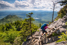A Woman Hiking Along The Grandfather Trail To McCrae Peak, Grandfather Mountain State Park, Banner Elk, North Carolina.