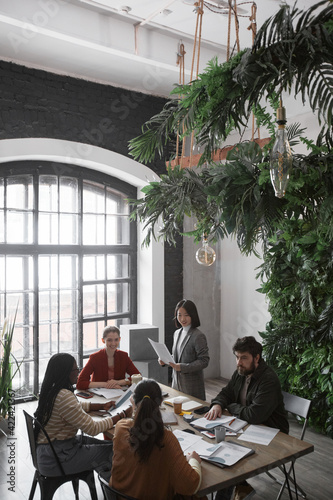 Wallpaper Mural Vertical high angle portrait of diverse group of business people meeting at tabl