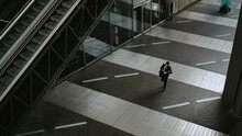 High Angle View Of Businessman Walking On Footpath