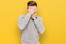 Young Redhead Man Wearing Casual Winter Sweater Covering Eyes And Mouth With Hands, Surprised And Shocked. Hiding Emotion