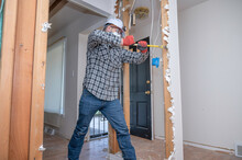 Contractor Removing Drywall