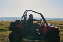 Man Enjoying Beautiful Sunny Day While Driving A Off Road Buggy Car