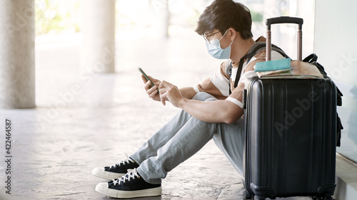 Fototapeta Man travel tourist wearing protective mask trip during corona virus covid-19 pandemic.. obraz