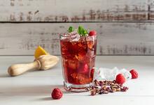 Hibiscus Ice Tea Or Karkade Lemonade With Raspberries, Mint, And Lemon