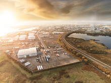 Aerial View On Galway City, Tilt Shift. Bus Maintenance Station In Focus. Sunset Sky.