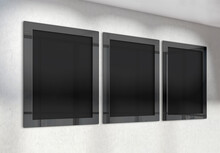 Three Vertical Frames Mockup Hanging On Wall. Mock Up Of Billboards In Modern Concrete Office Interior 3D Rendering