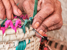 An Old Working Woman And Making Handcraft By Dried Palm Tree Leaves