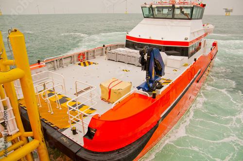 Crew transfer vessel on docking station of parent vessel Wallpaper Mural