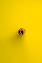 Heart Shaped Cross Section Of Cinnamon Stick On Yellow Background