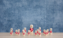 Wooden Dolls With Red Heart On Blue Background, Health Concept