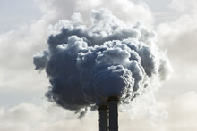 Smoking Chimney Pipes Of A Electro Power Station Plant  Causing Air Pollution.