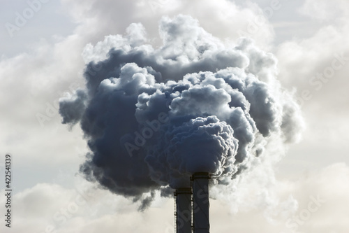 Foto Smoking chimney pipes of a electro power station plant  causing air pollution