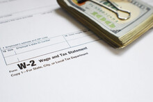 W-2 Employee Yearly Wage Tax Form With Money Close Up