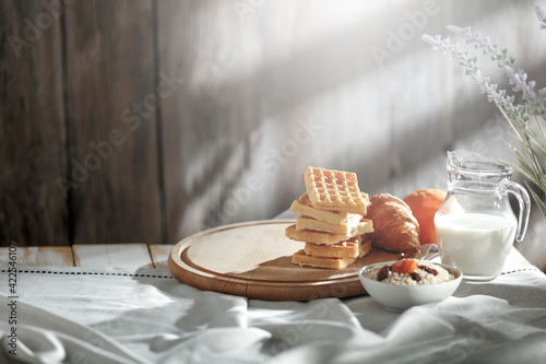 Spring morning breakfast in a country cottage under the natural sun Fotobehang