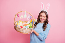 Photo Of Lady Presenting Look Easter Basket Toothy Smile Wear Hare Ears Headband Blue Pullover Isolated Pink Background