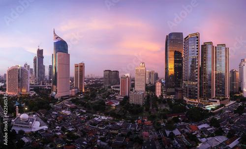 Fotografija Stunning sunset over Jakarta skyline where modern office and condominium towers