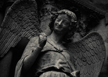 Smiling Angel On Facade Of Notre Dame Cathedral Of Reims, France. Black White Historic Photo.