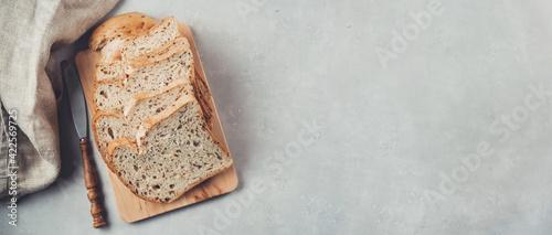 Canvas Organic sour dough non-gluten bread on wooden board