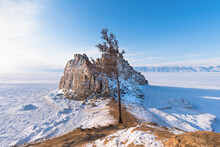 Sacred Shamanka Mountain On Olkhon Island In Winter. View Of The Frozen Lake Baikal On A Sunny Day