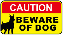 A Sign That Says : CAUTION BEWARE OF DOG