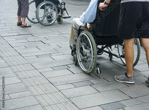 Papel de parede Disabled People  in wheelchair at the street