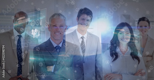 Digital interface and network of connections against portrait of business people smiling at office