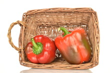 Two Red Organic, Bell Peppers With A Basket Of Vine, Close-up, Isolated On White.