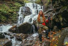 Waterfall. Woman Tourist Walks Near The Larger Waterfall.