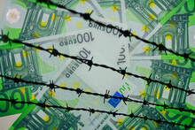 Barbed Wire On Financical  Backgrond Of 100 Euro Banknotes Circle