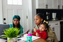 Black Family Paying Bills At Home, Soldier