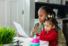 Focused Military Woman Working From Home At Laptop And Paying Bills