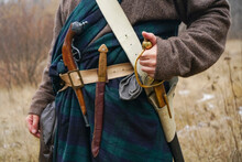 Retro Old Saber, Knife  And Aged Gun Hang On The Belt Of The Scottish Cape