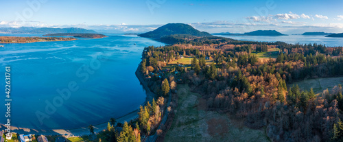 Fototapeta Aerial View of Lummi Island, Washington. Springtime warm evening light on the south end of Lummi island located in the Salish Sea area of the Pacific Northwest near Bellingham, Washington. obraz