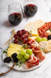 canvas print picture Charcuterie board with variety of cheese and meat