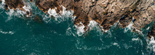 Top View Of The Sea Waves Hitting The Rocks.