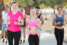 People Leading Healthy Lifestyle, Jogging During Outdoor Workout On City Seafront