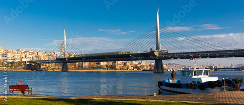 Scenic view of cable-stayed metro bridge across Golden Horn with modern cityscape of Beyoglu district of Istanbul on sunny day, Turkey Fototapet