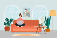 A Girl With A Laptop Sits On A Sofa In A Cozy Living Room. Work At Home And Freelance Concept.
