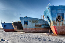 Cargo Ships Are In A Shipyard Frozen Into The Ice.