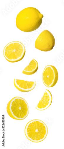 Fototapeta Fresh ripe lemons falling on white background obraz